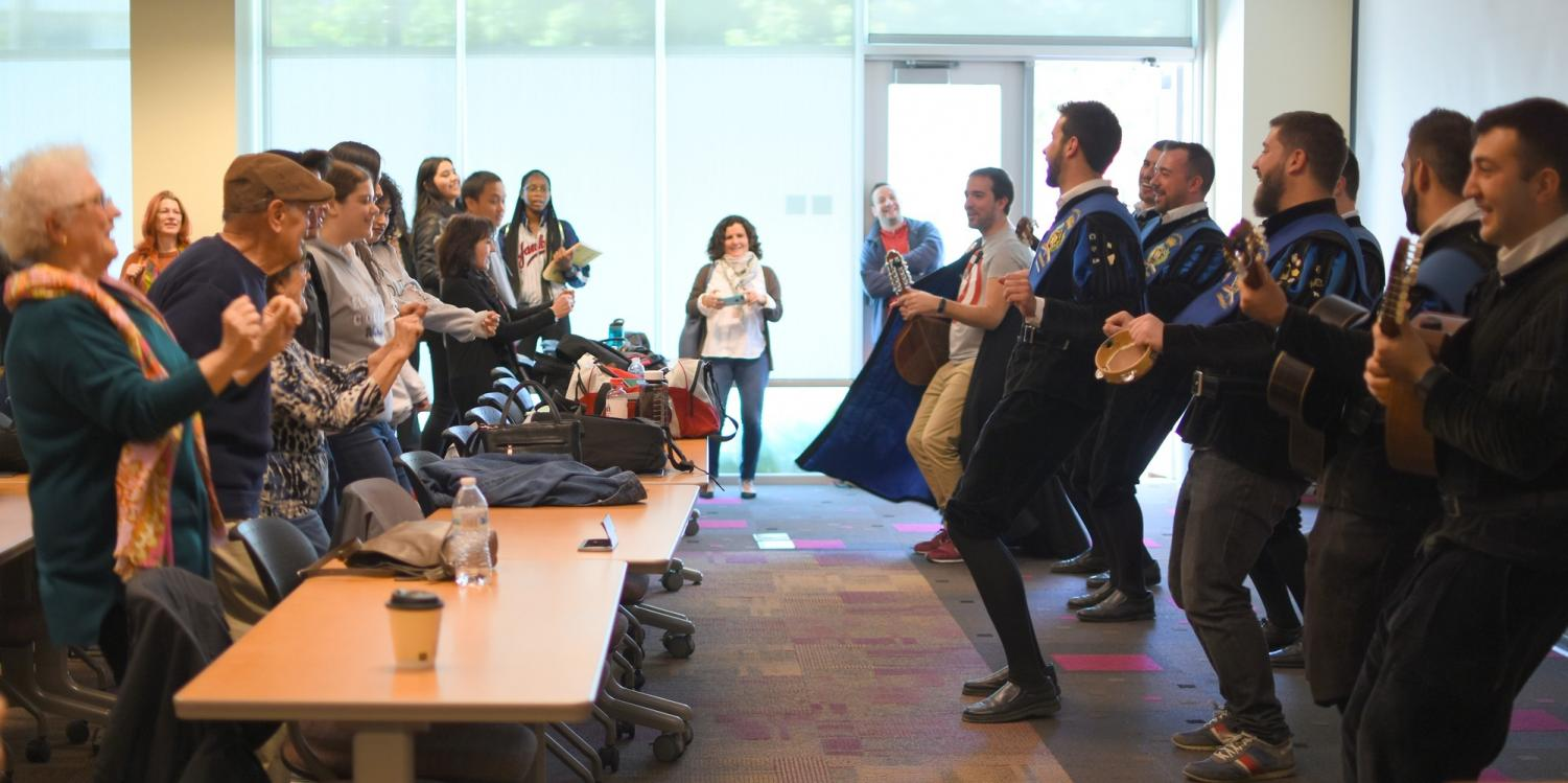 Spanish singing La Tuna group turns Distance Learning Center into a dance hall