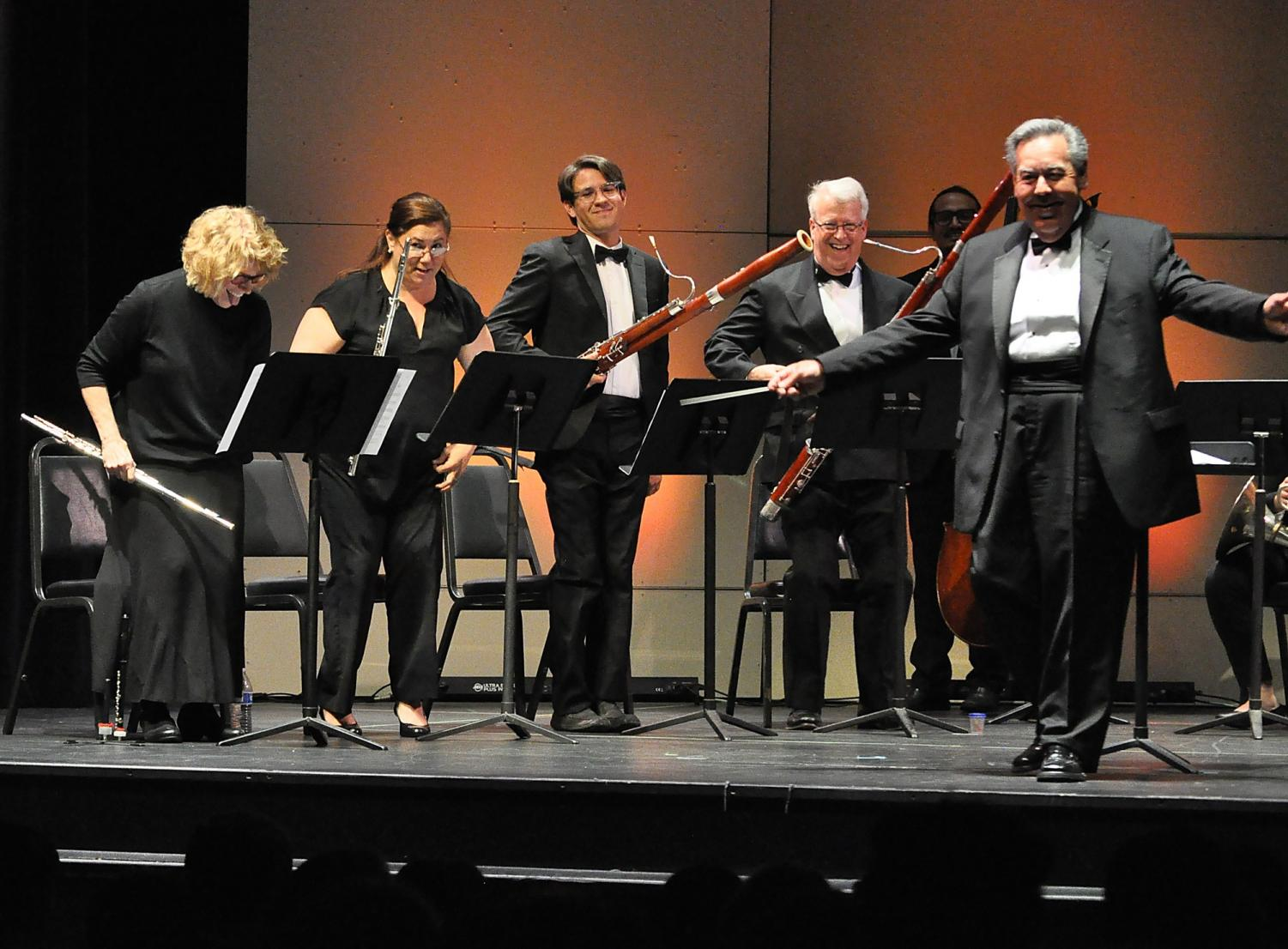 The conductor, Hector Salazar (right) and all the musicians getting an applause end of the performance at ECC Campus Theatre on Saturday, April 21. Photo credit: Miyung Kim