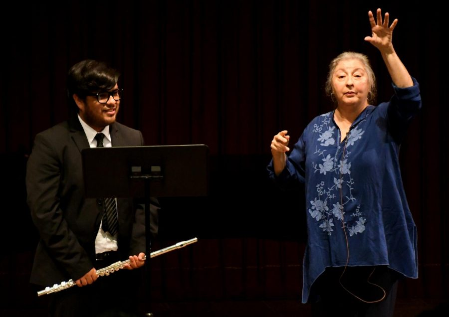 Alexander Technique Certified Teacher Pamela Blanc works with flutist Miguel Mendez to optimize his performance potential at the Haag Recital Hall, on Thursday, March 29, 2018. Photo credit: Jack Kan