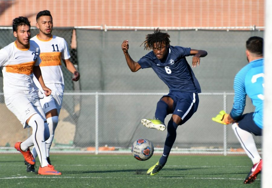 ECC midfielder Jean-Pierre Dejean Macksa (6) strikes the only Warrior goal during the ECC-L.A. Harbor College game at the Athletics Field on Friday, Sept. 28. The game ended tied at 1-1. (Jack Kan/Union) Photo credit: Jack Kan