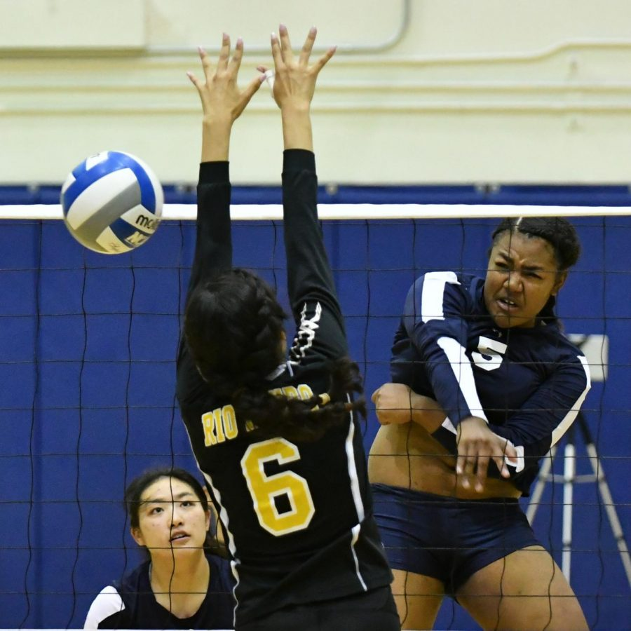 Deeann+Smith+%28No.5%29+spikes+the+ball+with+conviction+past+a+Rio+Hondo+blocker+on+Wednesday%2C+Oct.+24+in+the+South+Gym.+Photo+credit%3A+Jack+Kan