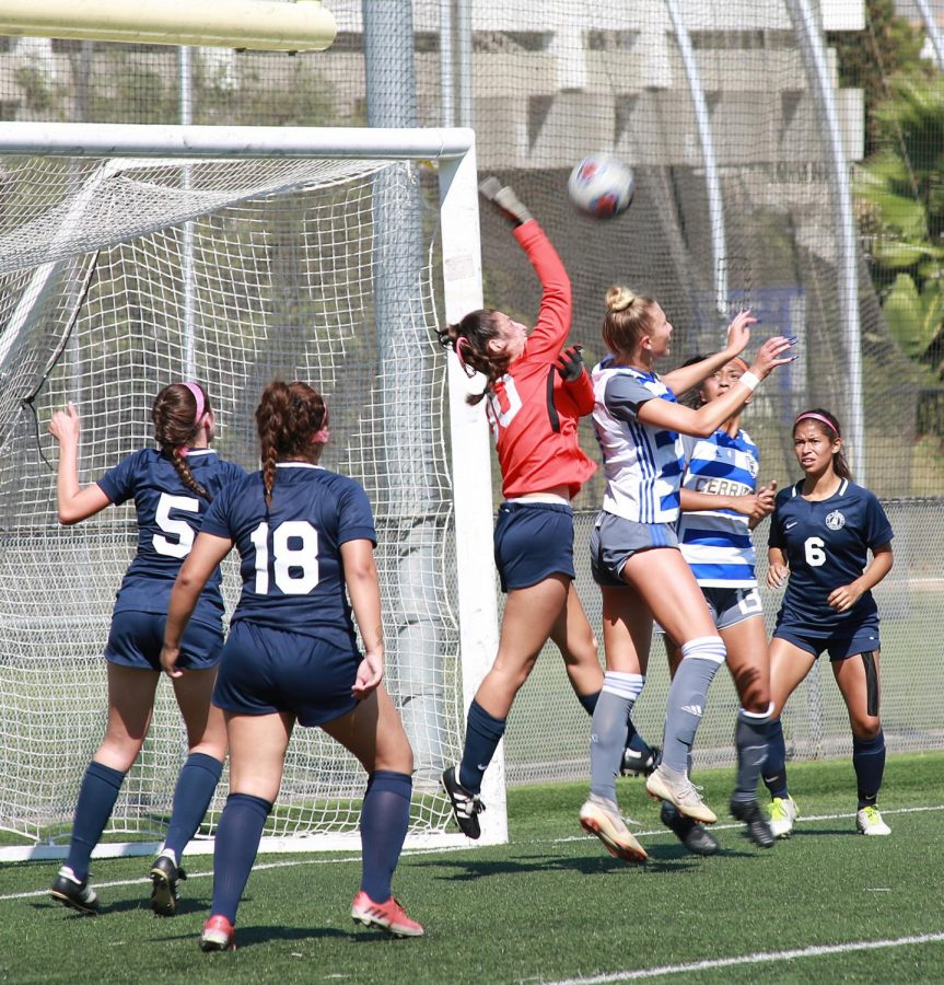 Joelle Niimi swats the ball away against Cerritos College at El Camino on Friday, Oct. 5, Photo credit: Mari Inagaki