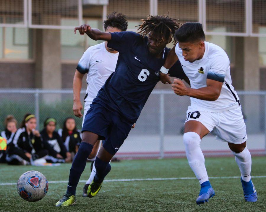 EC midfielder Jean-Pierre Dejean-Macksa fights off Rio Hondo defender on Tuesday, Oct. 16 at El Camino College. Photo credit: Darwyn Samayoa