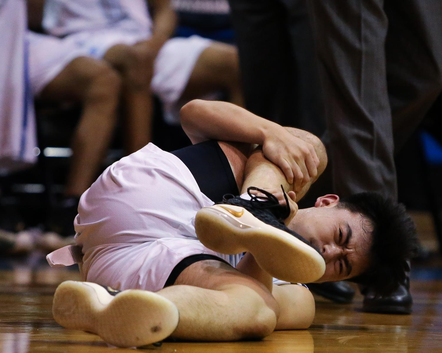 EC Warriors guard, Kyle Baba, suffers a right leg injury in the dying seconds of the game on a layup attempt, during the EC Warriors vs Pasadena City College men's basketball game at El Camino on Friday, Nov. 9. Photo credit: Darwyn Samayoa