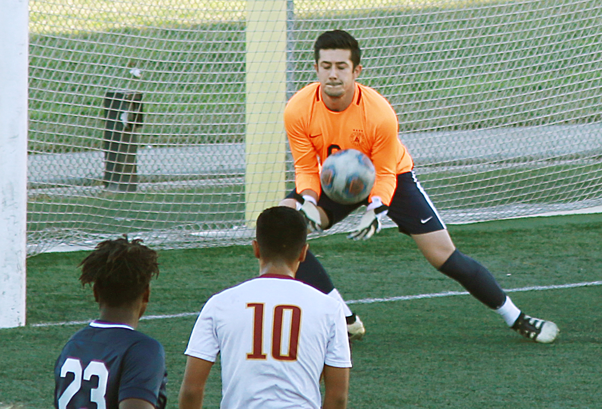 587187a4d52 EC goalkeeper, Brandon Cardenas, catches the shot on goal from Pasadena City  at El Camino College, on Friday, Nov. 9. Photo credit: Mari Inagaki