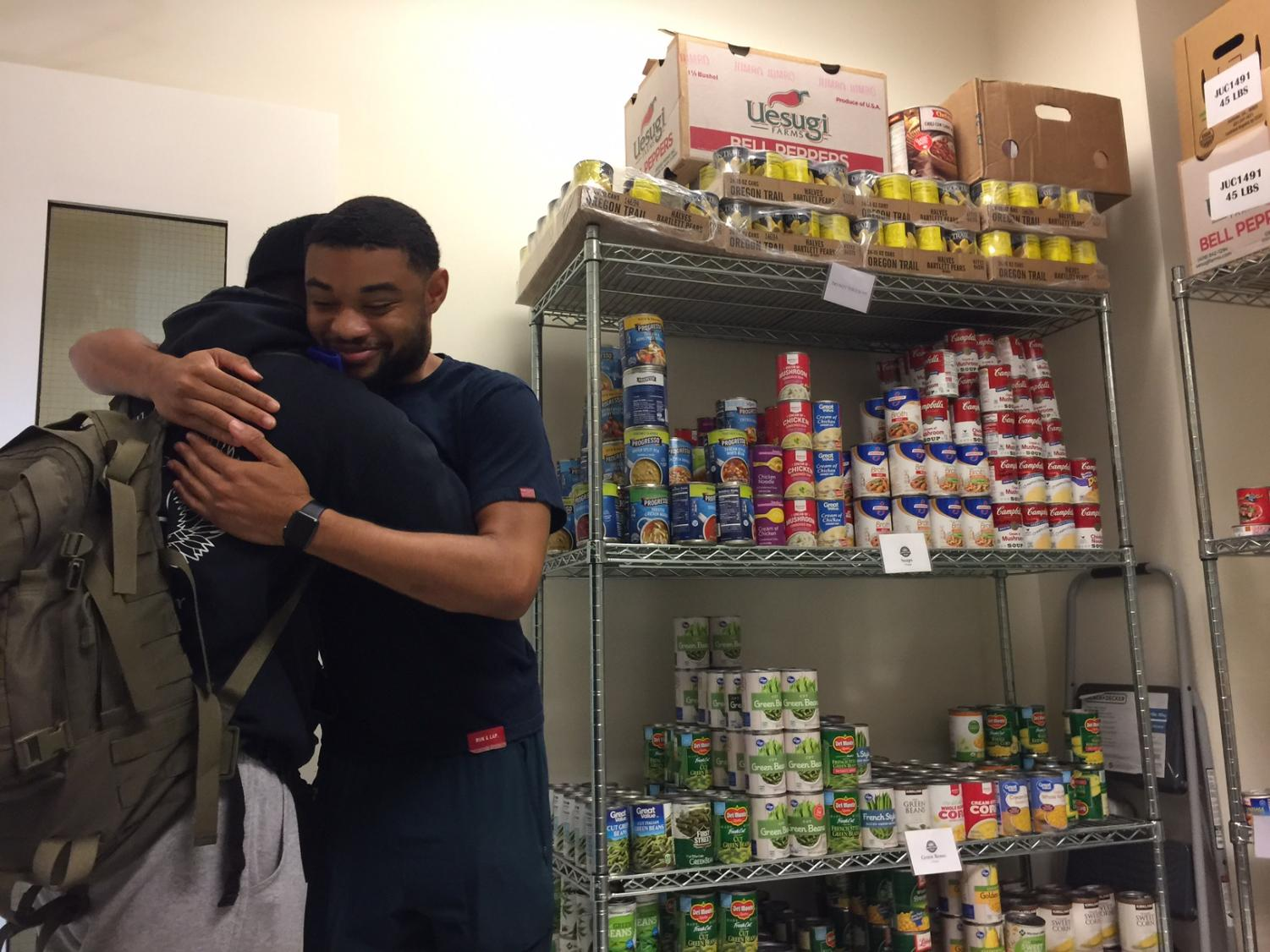 Sebastian Alejandro  Araque Vera,19, Chemistry major, and Isaiah Robinson, 20, Computer Science major and assistant at the Warrior Food Pantry,  thankful the day before Thanksgiving.