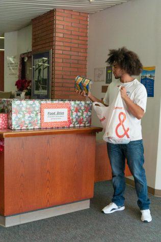 Hodari Yusef Harris II, 19, English/ Poly Science making food donations at the Library.