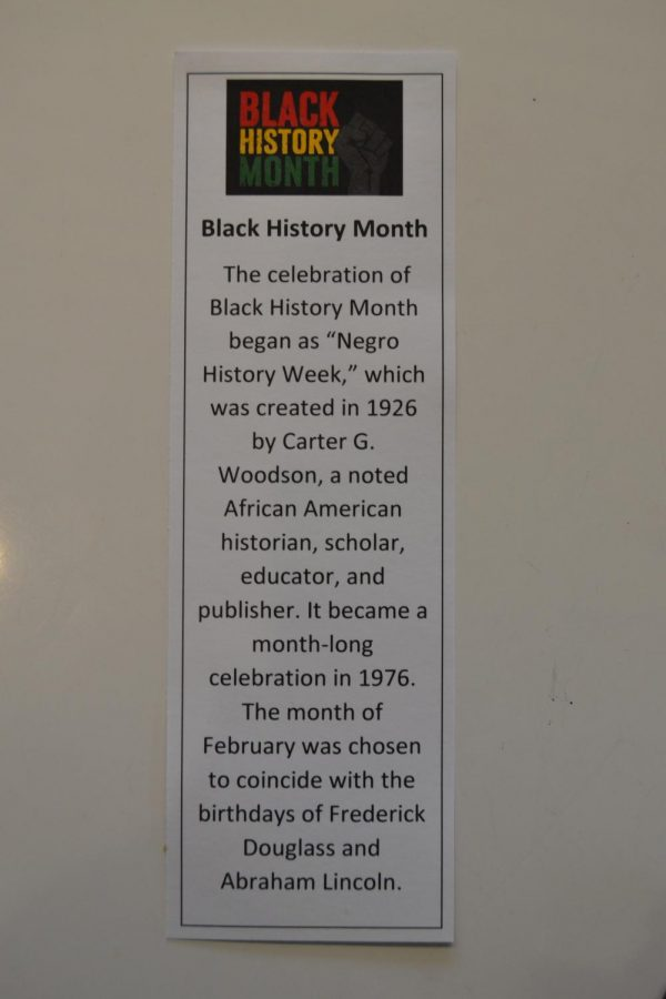 Tables are filled with laminated strips explaining the history of Black History Month. Feb.14, 2019