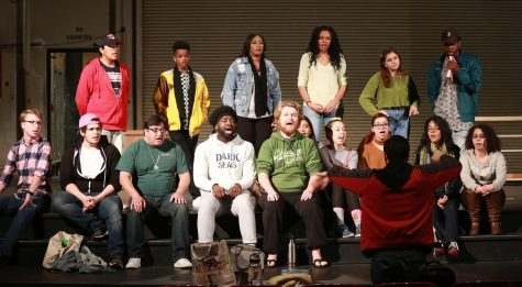Student director rehearses with cast for the Fine Arts Spectacular