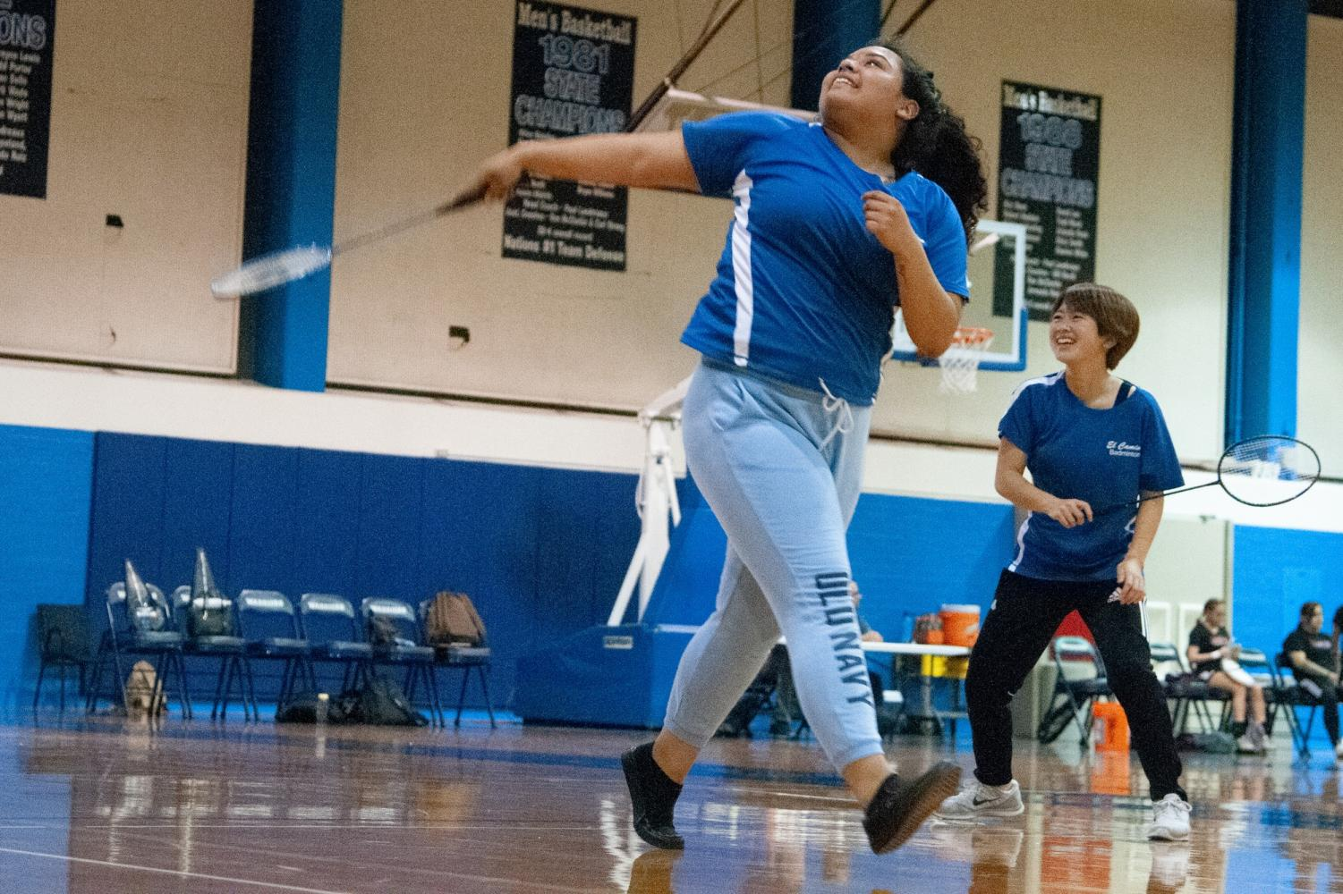 Warriors badminton players Angela Vargas-Gonzalez (front) and Miya Kawguchi (back) rally during a doubles match against Compton on Friday, March 15 at El Camino's North Gym. The energy in the building was light and relaxed, often with players making jokes with one another. Photo credit: Elena Perez