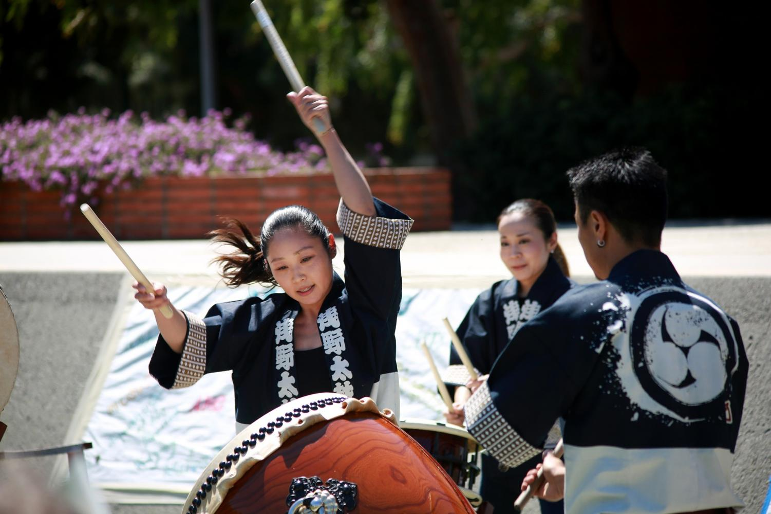 A member of the UnitOne of Asano Taiko U.S. plays the drums during the 19th annual Cherry Blossom Festival on Thursday, March 28. Photo credit: Mari Inagaki