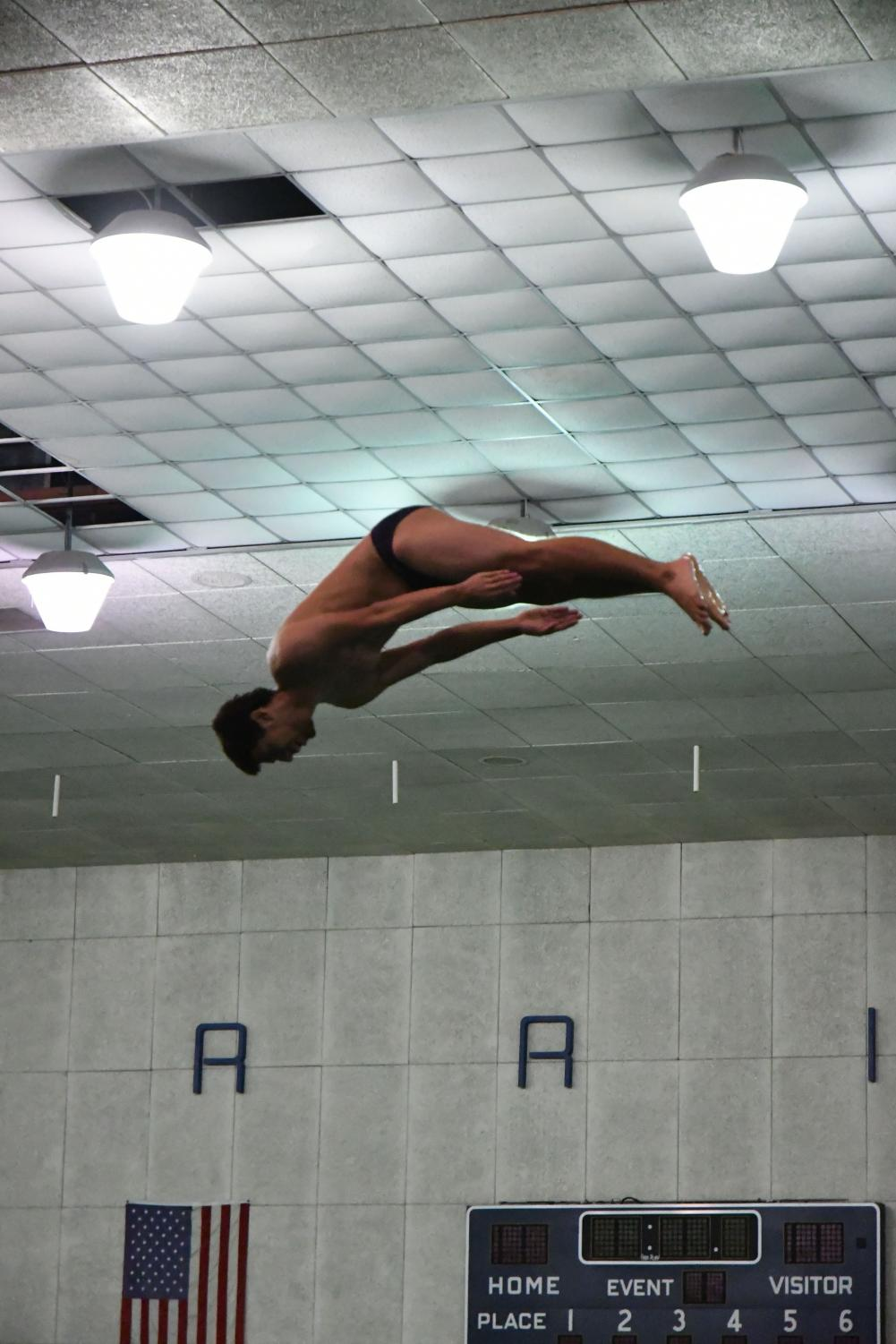 Taylor Trejo of the EC Warriors men's diving team performing a dive during the South Coast Conference Diving Invitational on Saturday, March 23 at the EC Pool. Trejo is one of many Warriors divers competing at this year's Southern California Diving Championships. Photo credit: Jun Ueda