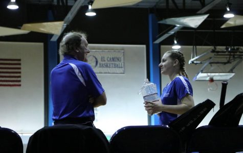 Warriors badminton coach John Britton and player Riley Arrowhead talking between matches versus East L.A. on Friday, March 29, at El Camino's North Gym. The Warriors have one last home game on Friday, April 5, versus Compton College. Photo credit: Anna Podshivalova