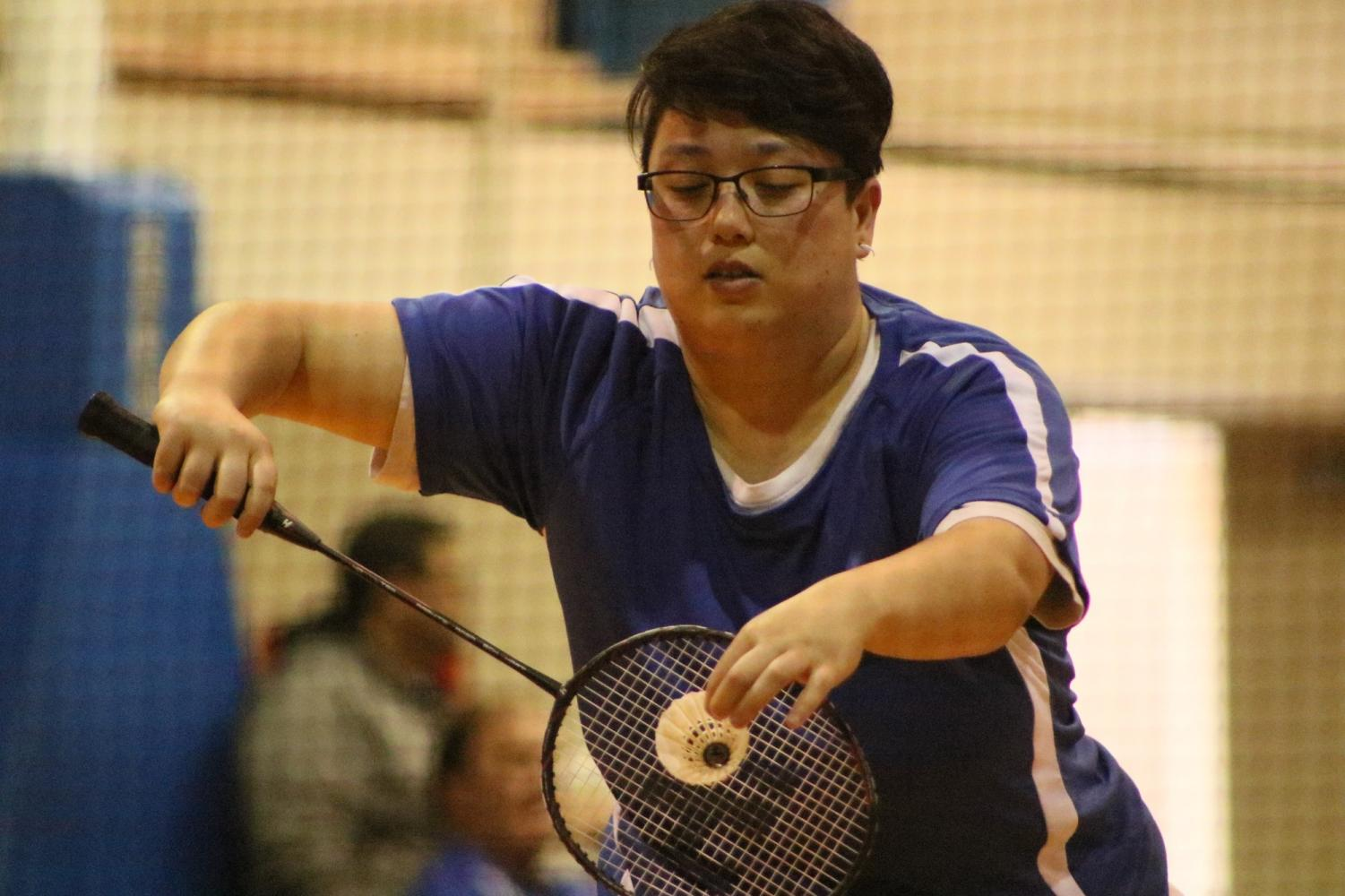 Warriors badminton player Sunya Unger serves during a doubles set against Compton College on Friday, April 5, at El Camino College. Sunya Unger and doubles partner Lauren Ritter went on to win both of their sets 21-18 and 21-11. Photo credit: Rosemary Montalvo