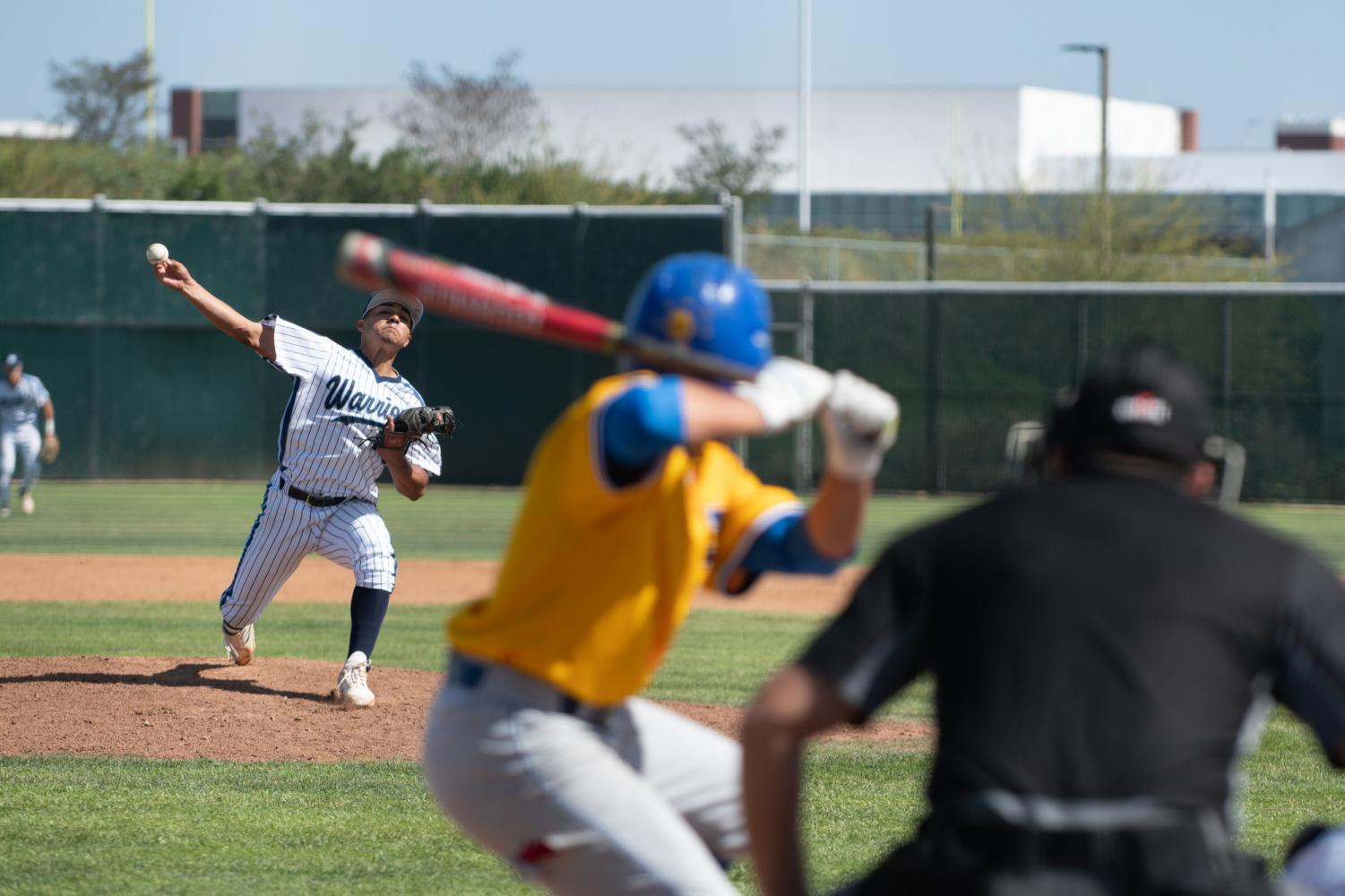 Warriors pitcher Aaron Orozco follows through on his pitch versus LA Harbor Tuesday, April 23, at Warrior Field. LA Harbor's lone run came in the fourth inning. Photo credit: Elena Perez