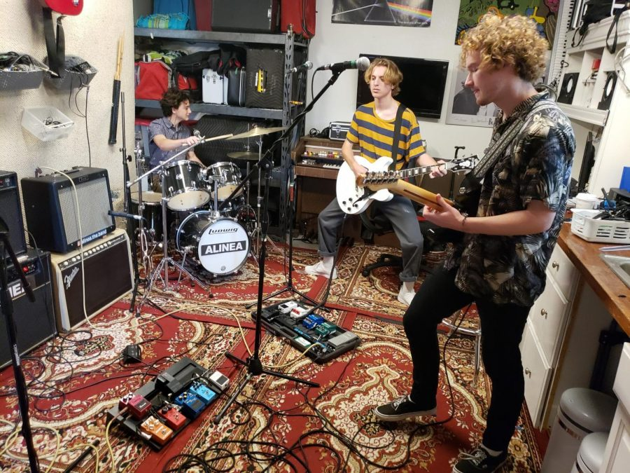 Lance Meliota, 18, drummer (left), John Barry, 18, guitarist and singer, and Ben Tyrrell, 20, guitarist and singer from the band Alinea rehearses for their performance at Beachlife Festival. Photo credit: David Rondthaler