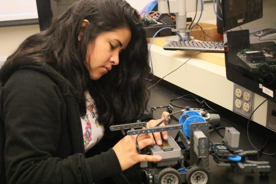 Gesenia Grajeda, 23, manufacturing technology major, builds a robot in the ITEC Building in Room 22 on Monday, May 6. Bigger robots are built by the Robotics Club for competitions. Photo credit: Rosemary Montalvo