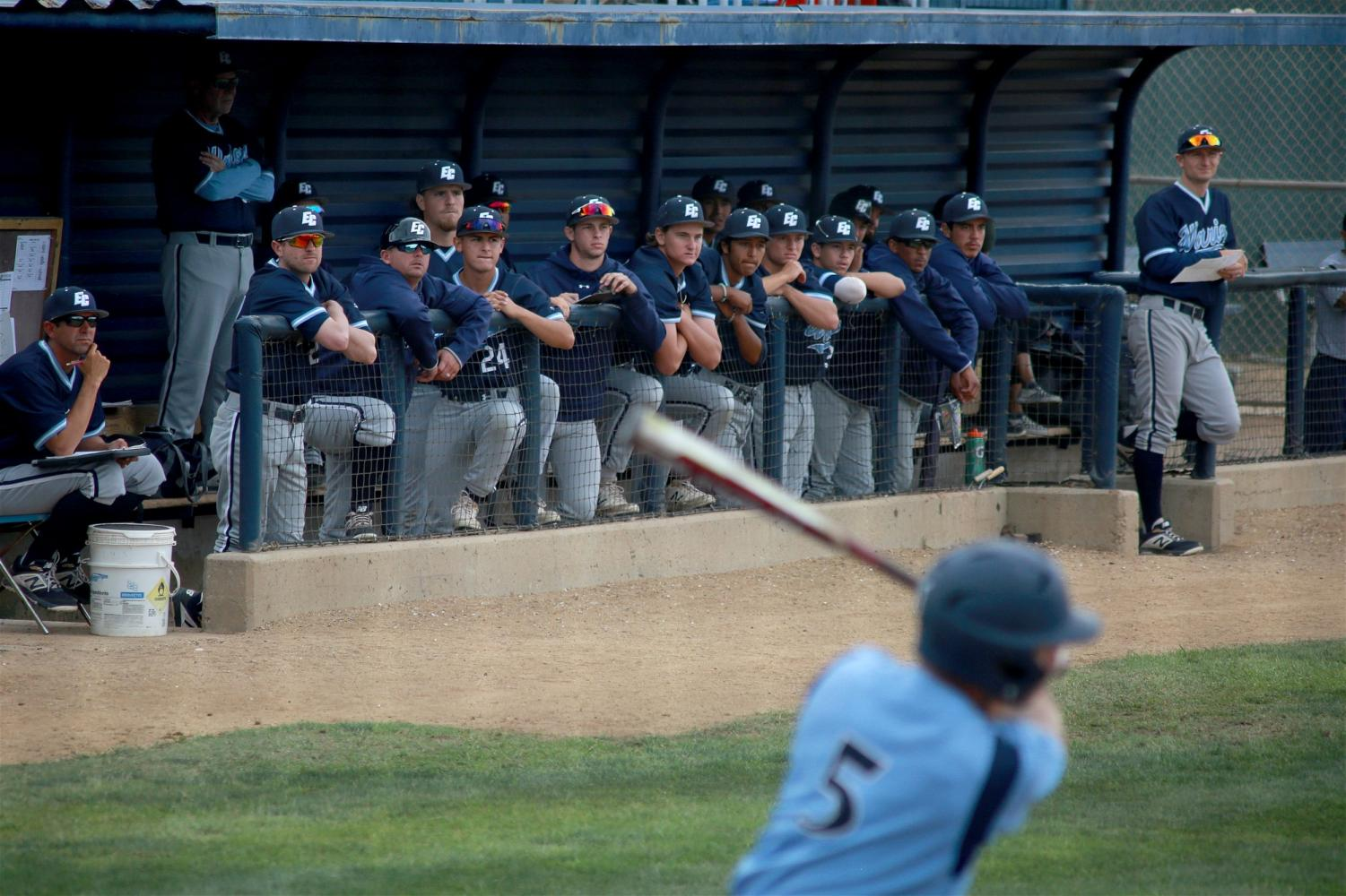 El Camino Warriors players watch Cypress Chargers catcher Eric Bigani up at the plate during Game 2 of their playoff series on Friday, May 10. The Chargers forced Game 3 for Saturday, May 11. Photo credit: Mari Inagaki