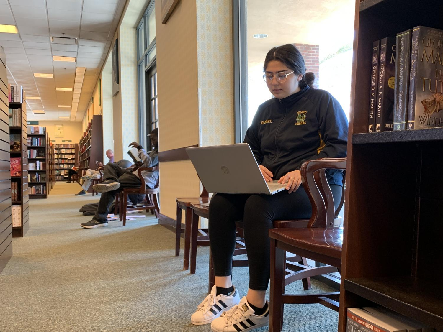 Bridgette Ramirez, 19, nursing major, works on a class assignment on her laptop at the top floor of a Barnes And Noble on May 11. It is an early Saturday morning and the quiet upstairs section of the bookstore brings Ramirez the solace needed to concentrate on her schoolwork. Besides being a full time student at El Camino College, she balances having a job at a daycare and must manage her time wisely. Photo credit: Kevin Caparoso