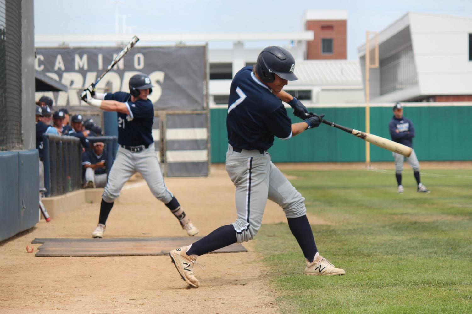 Warriors infielder and right-handed pitcher Spencer Long (front) and outfielder Ty Conrad (back) take practice swings before the beginning of the sixth inning of Game 2 against the Glendale Vaqueros on Saturday, May 18, at Warrior Field. The Warriors won the game, swept the series and will play in the final four of the 2019 California Community College Athletic Association State Championship. Photo credit: Devyn Smith