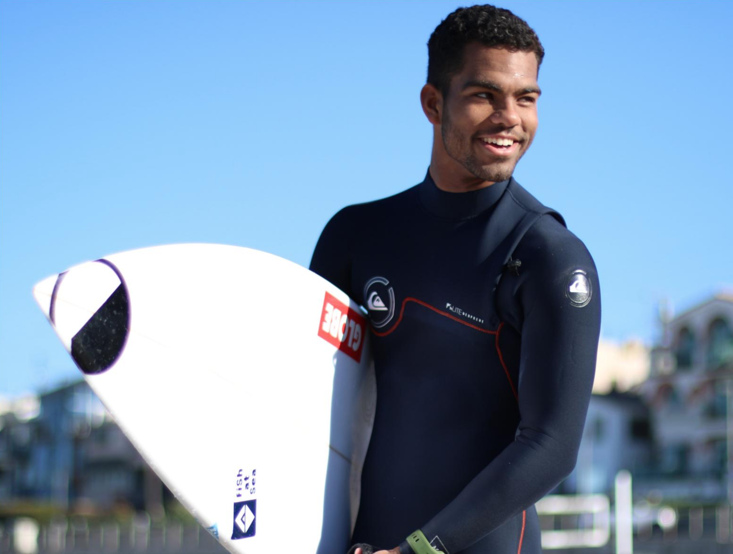 Hunter Jones with his surfboard, at El Porto in Manhattan Beach. Jones, now a former El Camino College student, is set to appear in the latest season of