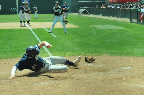 Warriors outfielder Ty Conrad slides home following a hit from teammate Joseph Borges against the Delta Mustangs on Saturday, May 25, at John Euless Ballpark in Fresno, CA. The Warriors won the game 5-3. Photo credit: Devyn Smith