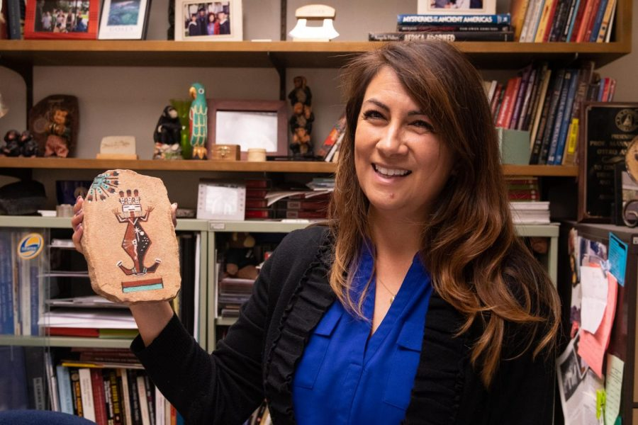 Angela Mannen, shows her souvenirs, a native American art piece, at El Camino College, May, 2, 2019. Photo credit: Elena Perez