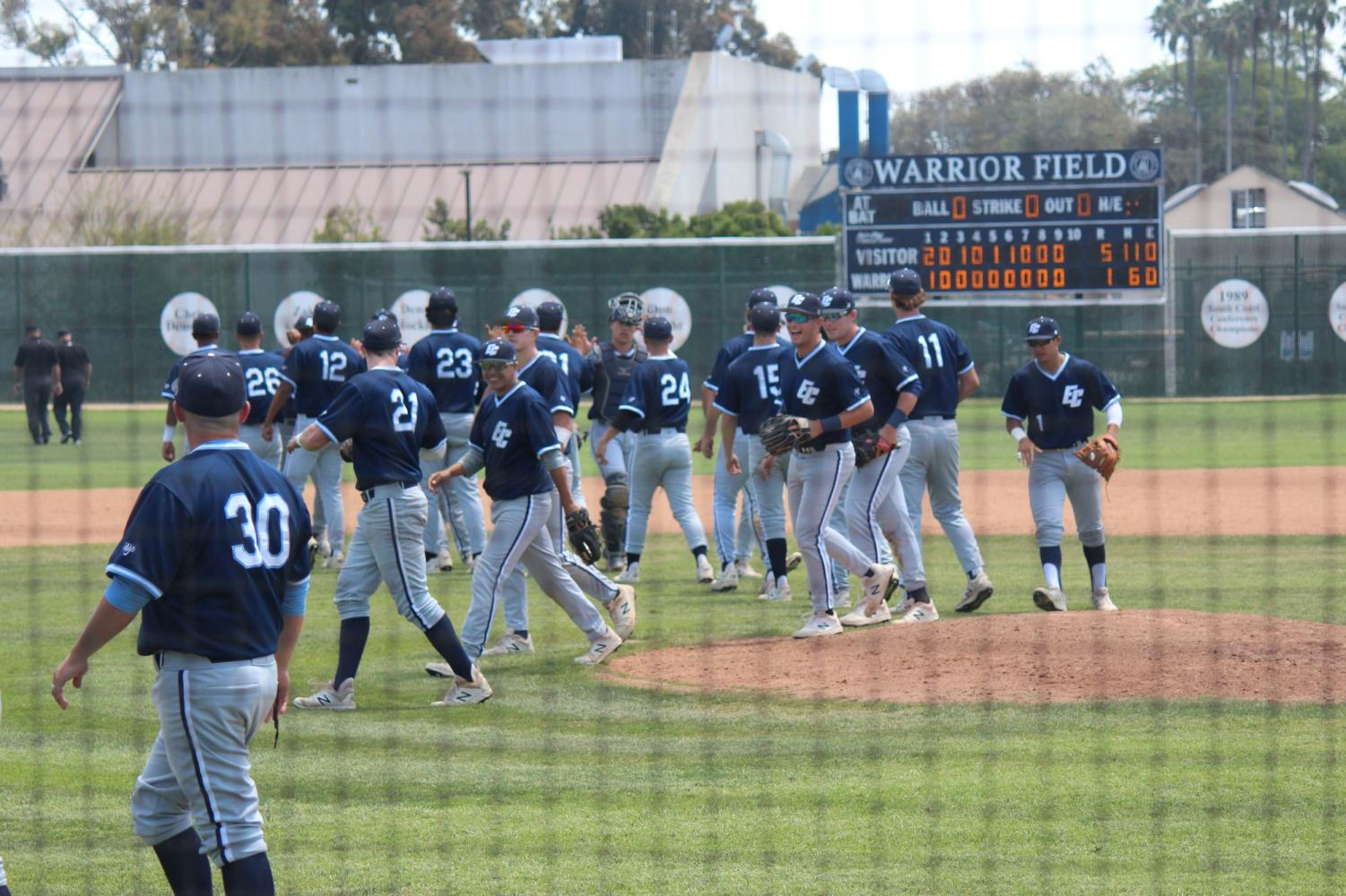 The El Camino Warriors celebrate following their Game 2 victory and series sweep of the Pasadena City Lancers Saturday, May 4, at Warrior Field. The Warriors scored five runs on 11 hits and committed no errors. Photo credit: Kealoha Noguchi
