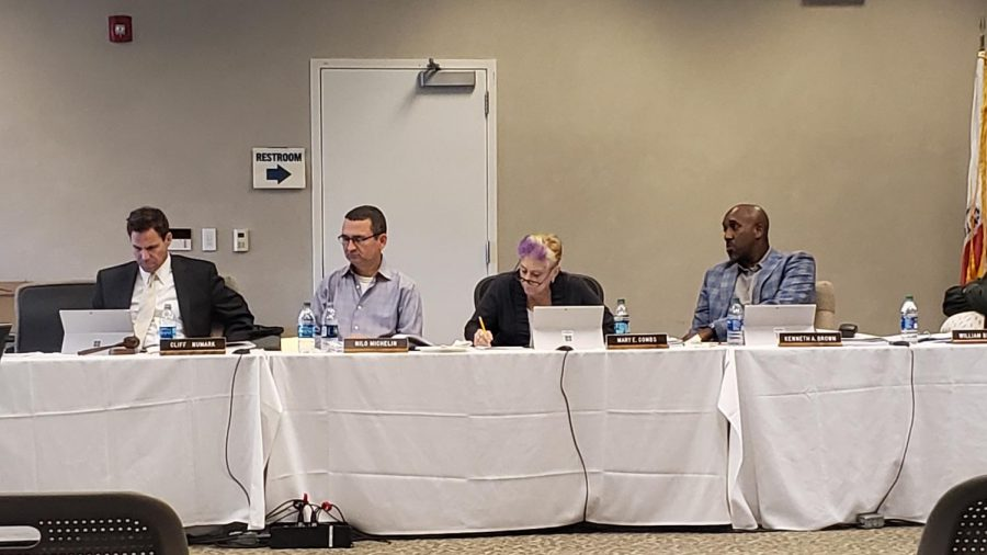 From left, Board of Trustees (BOT) President Clifford Numark, Trustee Nilo Michelin, Secretary Mary E. COmbs and Trustee Kenneth Brown listen to EC President Dena Maloney at a BOT meeting on Monday, August 19. This BOT meeting is the first of the fall 2019 semester. Omar Rashad / The Union
