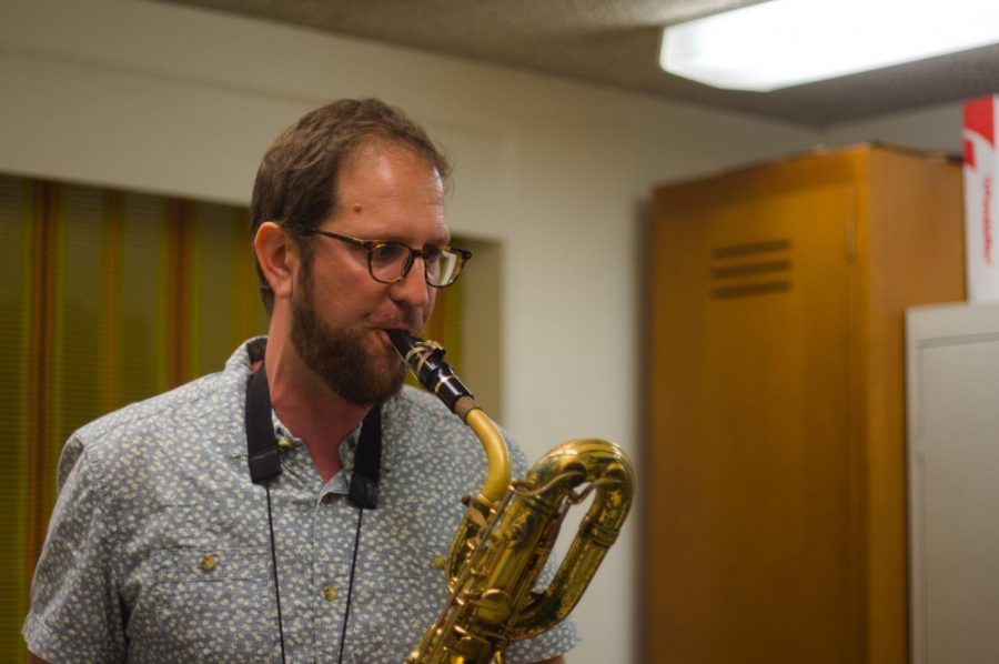 "Jazz professor, David Moyer, plays his baritone sax in his office on Wednesday, Sept. 24. Moyer performed on tour with The Gerald Wilson Orchestra, Big Daddy Kane and Tears For Fears before teaching at El Camino College. ""It was eye-opening to be able to travel to these places that I otherwise would never be able to travel,"" Moyer said. Photo credit: Jeremy Yap"