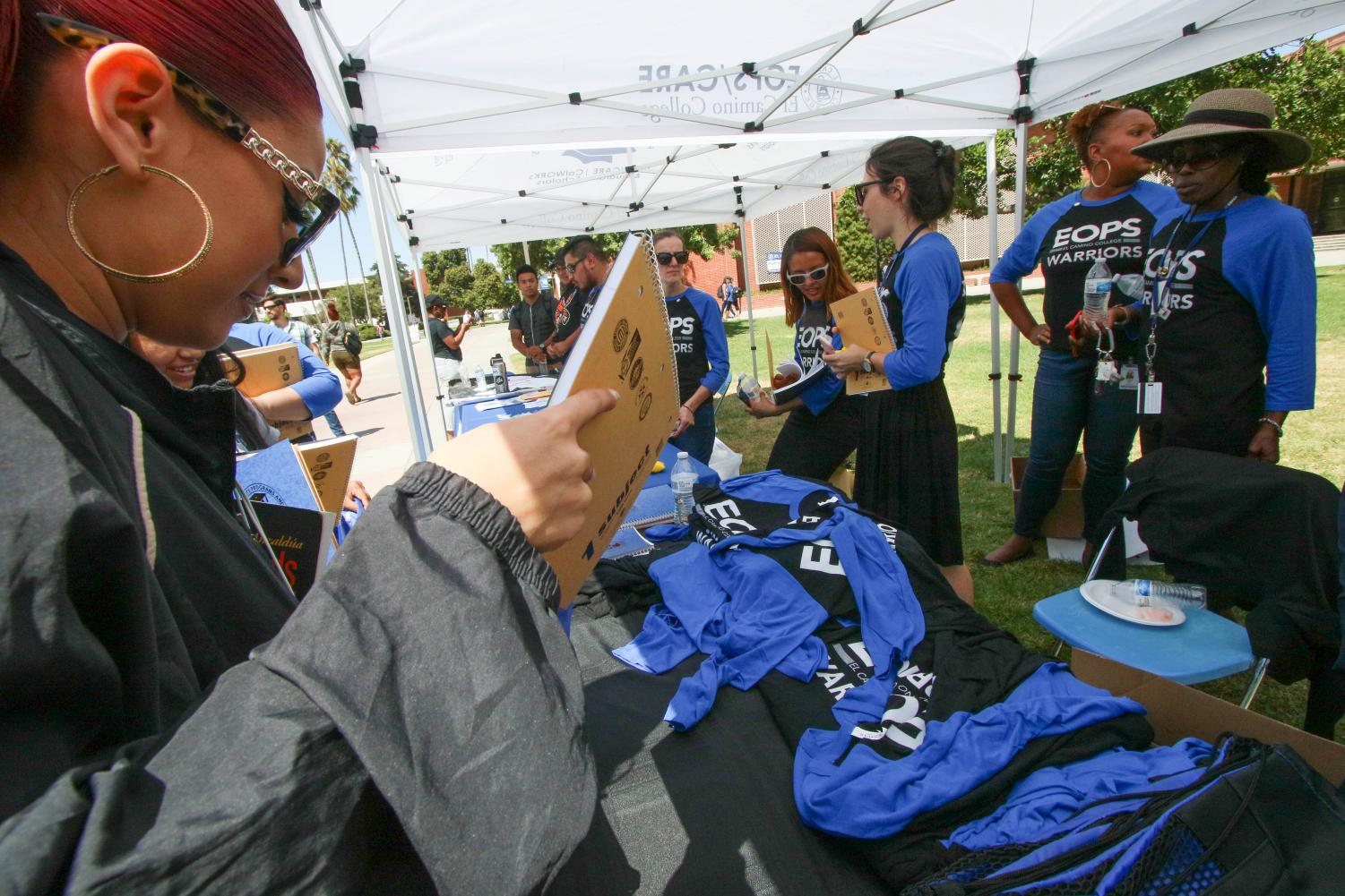 The EOPS booth gives out free school materials and gear to students at its 50 year celebration at the Library Lawn Thursday, Sept. 5. The event meant a lot for Assistant Director David Brown as he has a long history with the program, he said.  Rosemary Montalvo/The Union