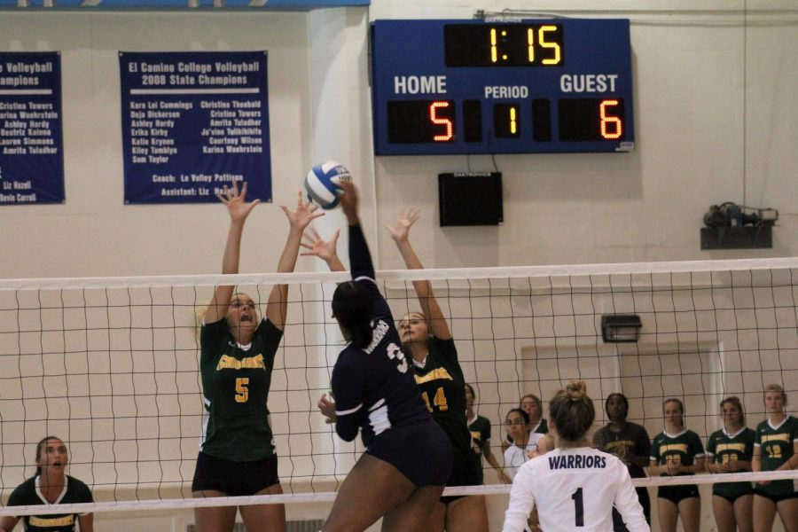 Warriors outside hitter Kayla Conley (No.3) spikes the ball past the Griffins' defense in an effort to tie the score during the first set of the game in ECC's South Gym, Friday, Sept 13. Jaime Solis/The Union