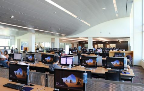The Study Center has a computer lab and tables for students to work collaboratively. Students can print from computers and rent calculators from the center. Omar Rashad/The Union