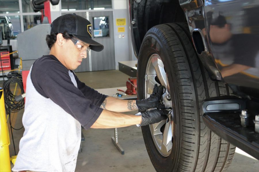 Automotive technology major Rene Ocegueda rotates a tire in his Automotive Technology 1 class. Career Education oversees over a dozen programs like Automotive Technology and is organizing an event in October to allow students to meet potential employers. Omar Rashad/The Union