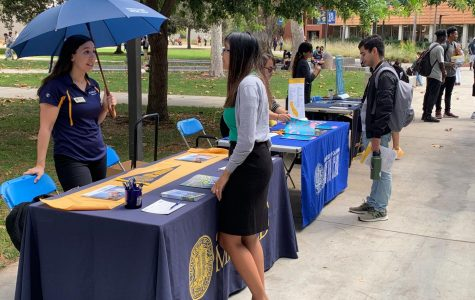 Janelle Cardenas, an admissions representative for UC Merced, talks with National University Representative Mary Anne Nguyen at the Transfer Day Fair on Thursday, Sept. 19. The fair gives students the opportunity to learn more about universities they could be interested in transferring to in the future. Kevin Caparaso/The Union