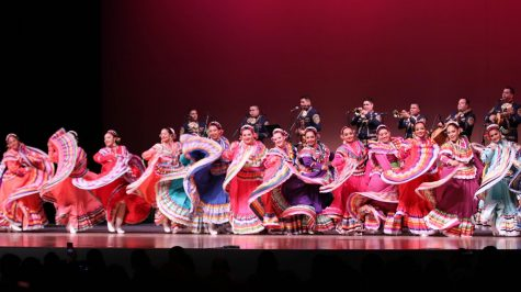 Members of Nuestras Raíces dance to traditional Mexican sones performed by Mariachi Los Reyes in ECC