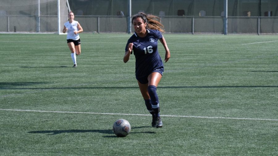 El+Camino+College+Women%27s+Soccer+team+forward+Monica+Bernardino+pushes+the+ball+passed+a+Moorpark+defender+during+the+first+half+of+the+match+against+Moorpark+College+on+Friday%2C+Sept.+27+at+Warrior+Field.+Bernardino+scored+the+first+goal+of+the+game+in+the+57th+minute+and+her+seventh+goal+on+the+season.+David+Odusanya%2FThe+Union