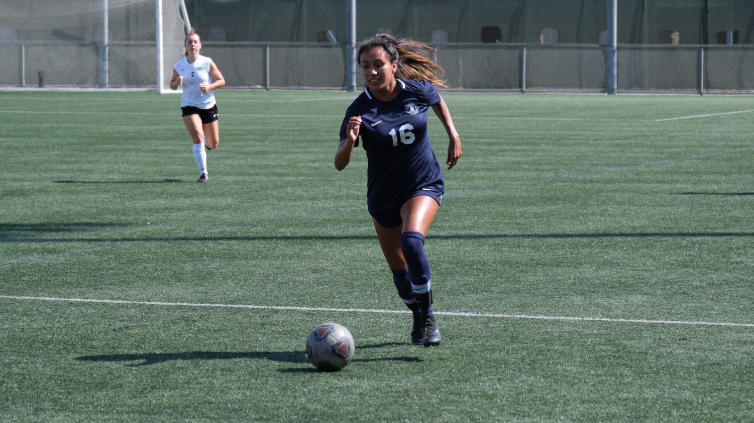 El Camino College Women's Soccer team forward Monica Bernardino pushes the ball passed a Moorpark defender during the first half of the match against Moorpark College on Friday, Sept. 27 at Warrior Field. Bernardino scored the first goal of the game in the 57th minute and her seventh goal on the season. David Odusanya/The Union