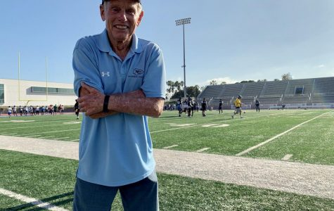 "Former head football coach John Featherstone stands in front of the Murdock Stadium field during football practice Wednesday, August 21. At the Warriors' homecoming game Nov. 16., The name ""Featherstone Field"" will forever be attached to the arena where he once played in his youth as a Warrior and coached later on during his 31-year-old career. Jose Tobar / The Union"