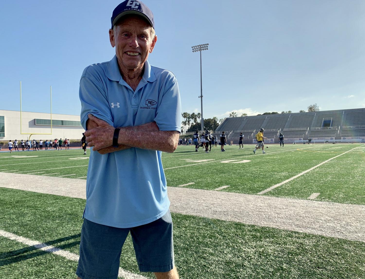 """Former head football coach John Featherstone stands in front of the Murdock Stadium field during football practice Wednesday, August 21. At the Warriors' homecoming game Nov. 16., The name """"Featherstone Field"""" will forever be attached to the arena where he once played in his youth as a Warrior and coached later on during his 31-year-old career. Jose Tobar / The Union"""