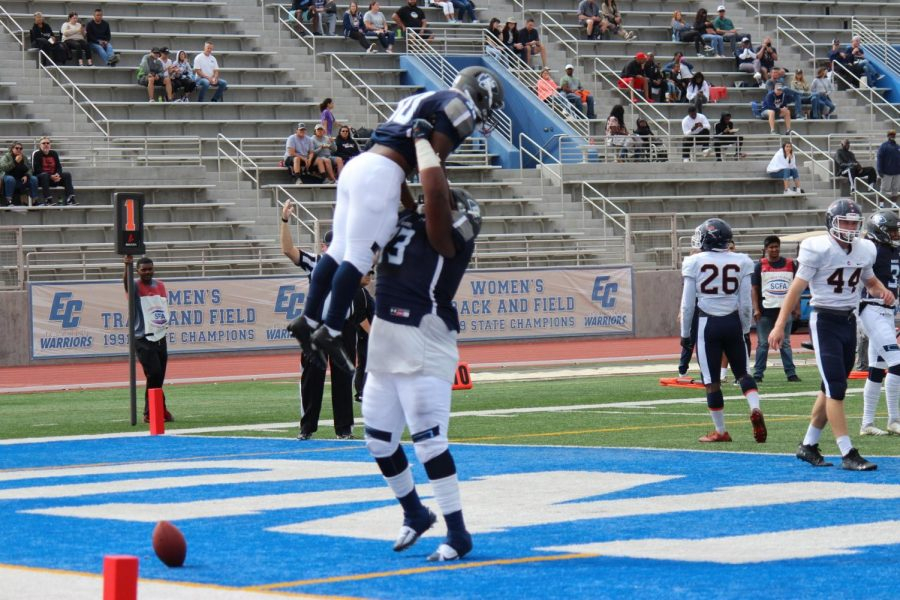 El Camino College football team running back Keyshawn Dupree, left, and offensive lineman Dajaunye Wingfield, right, celebrate Dupree's first touchdown in the third quarter of the game against Orange Coast College on Saturday, Sept. 28 at Murdock Stadium. Dupree had two carries in the game, both resulting touchdowns. Kealoha Noguchi/The Union