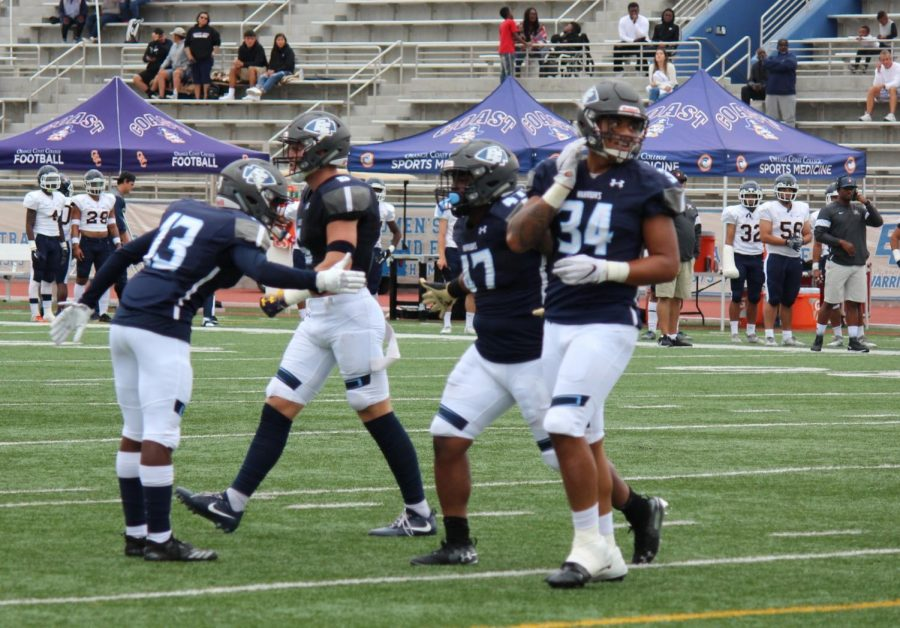 Players from El Camino College football team celebrate a defensive stop to force a punt in the third quarter against Orange Coast College on Saturday, Sept. 28 at Murdock Stadium. Kealoha Noguchi/The Union