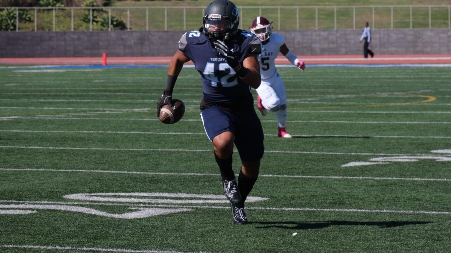El Camino College's linebacker Justin Sanchez returns a interception for a 28-yard touchdown in the first half against Mt. San Antonio College on Saturday, Oct. 26. The Mounties last minute comeback gives ECC their first conference loss of the season. David Odusanya/The Union
