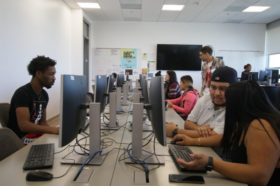 A group of students and staff work on computers during a FAFSA and Dream Act Application workshop at the Financial Aid Lab on Friday, Oct. 18. The lab is located in the new Student Services Building at El Camino College. Viridiana Flores/The Union