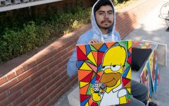 Daniel Galindo displays his artwork on a bench outside of El Camino College's Schauerman Library on Thursday, Sept.19. Justin Traylor /The Union.