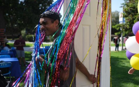 An ECC student walks through the coming out door during the National Coming Out Day event at the El Camino College Library Lawn on Thursday, Oct. 10. David Odusanya/The Union
