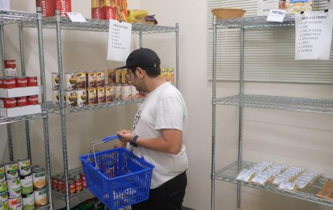 An El Camino College student peruses the racks at the Warrior Pantry on Friday, Oct. 18. The food pantry recently received a $10,000 grant from Los Angeles County Supervisor Janice Hahn, which will help purchase food items. David Odusanya/The Union