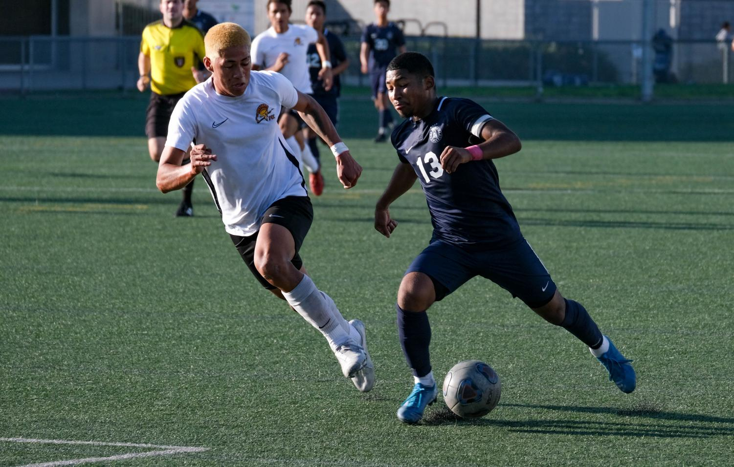 El Camino College men's soccer midfielder Melvyn Perez -Cortez moves the ball past a Pasadena College defender during a home game at the ECC Field on Tuesday, Oct. 29. The Warriors won 2-0. David Odusanya/The Union