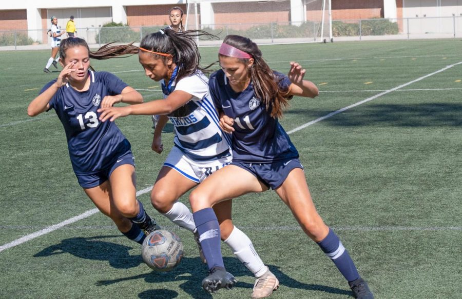 El Camino College women's soccer team No. 13, Ashley Herm and No. 11 Desiree Jeanes fight for possession of the ball against a Cerritos College player at ECC Field on Friday, Oct. 4. Cerritos defeated El Camino 2-1. David Odusanya/The Union