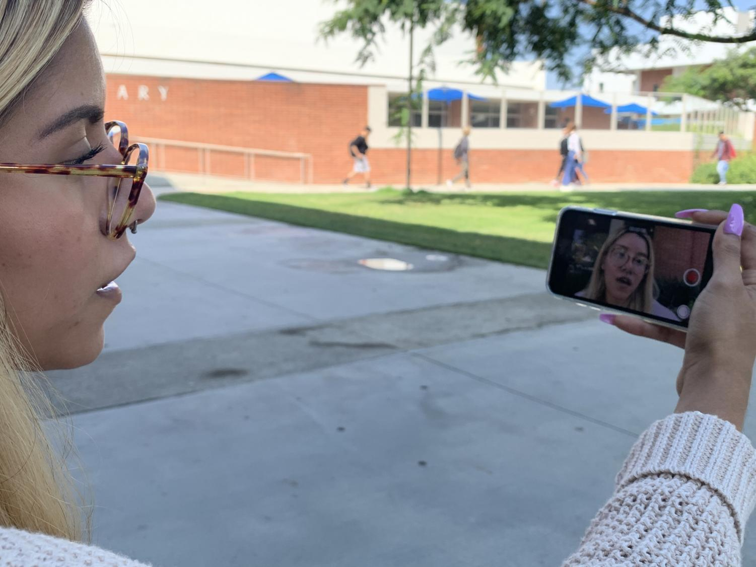 "Ruth Maldonado, 19, psychology major, sings a cover of Lana Del Rey's song ""Lust for Life"" outside of El Camino College's Schauerman Library on Monday, Sept. 23 for her YouTube channel. ""I want my voice to be heard,"" Maldonado said. Patrick Ezewiro/The Union"